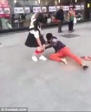 Girls pants pulled down in public