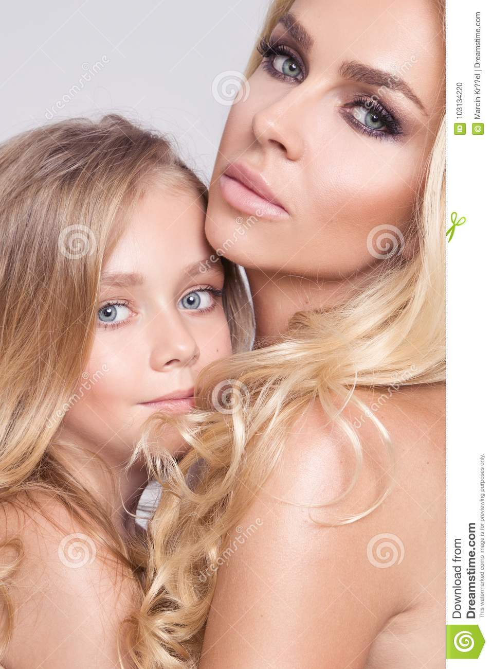 Nude blonde mother and daughter